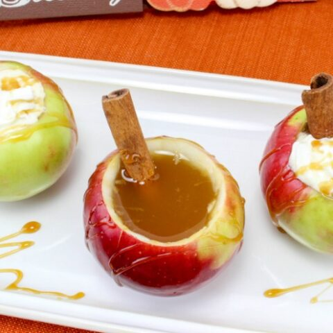 Apple cups with apple cider and whipped cream