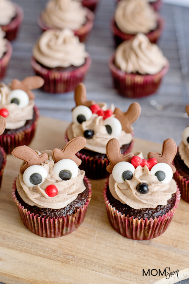 Reindeer Cupcakes with Cinnamon Cream Cheese Frosting are fun yet amazing delish cupcakes that will be a hit at any holiday gathering this year!  These cupcakes have the perfect combination of holiday flavors such as ginger, cinnamon, cloves, and vanilla.   #momskoop #reindeercupcakes #cupcakes #holidaycupcakes