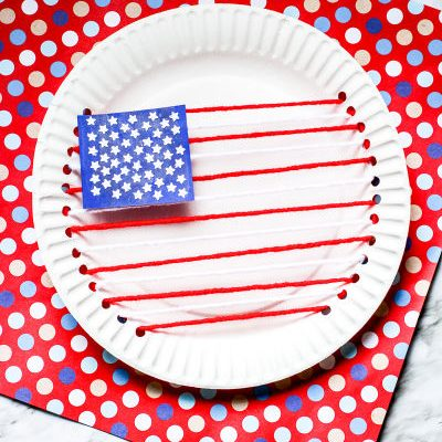American Flag made out of paper plate and yarn