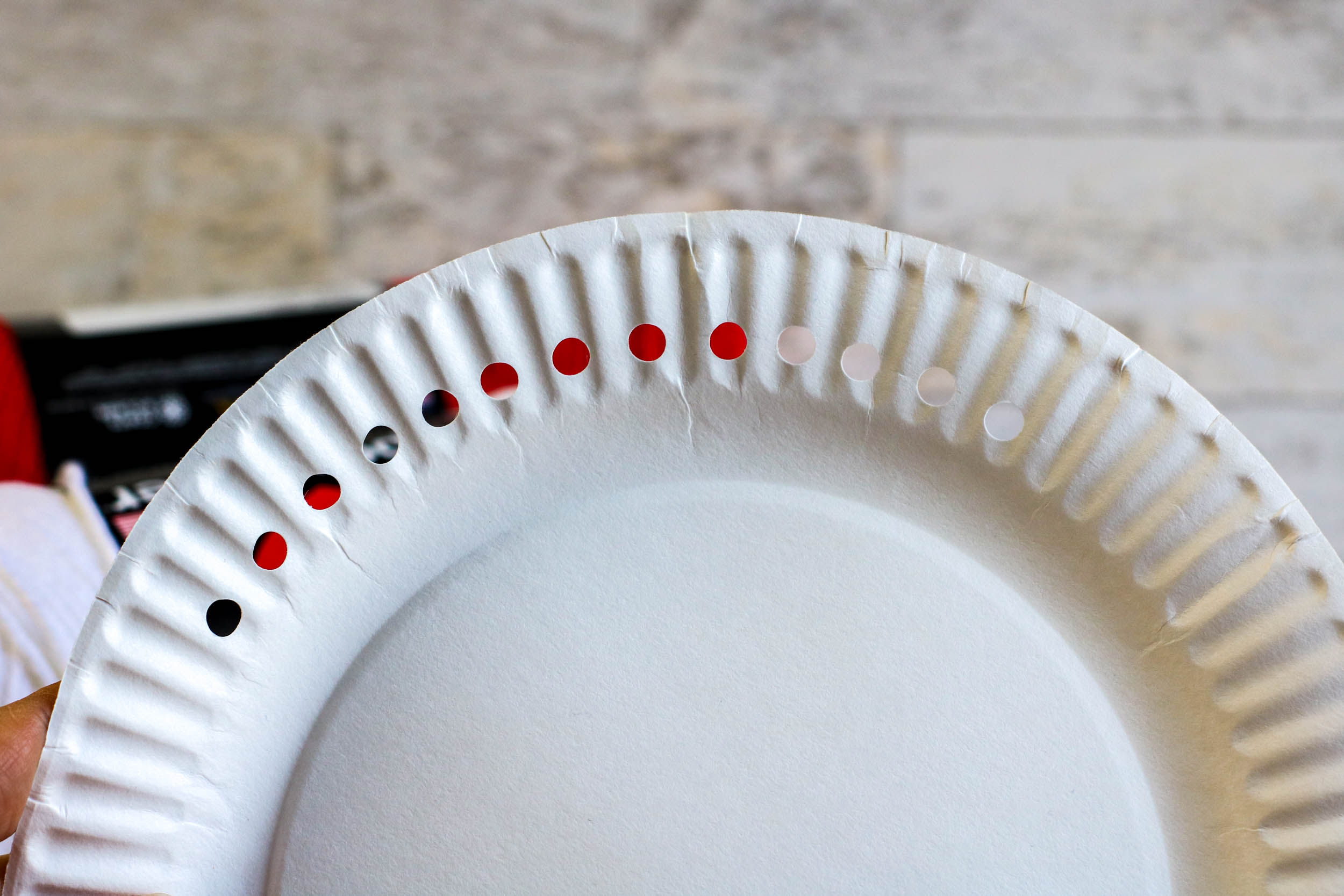 Paper plate with holes